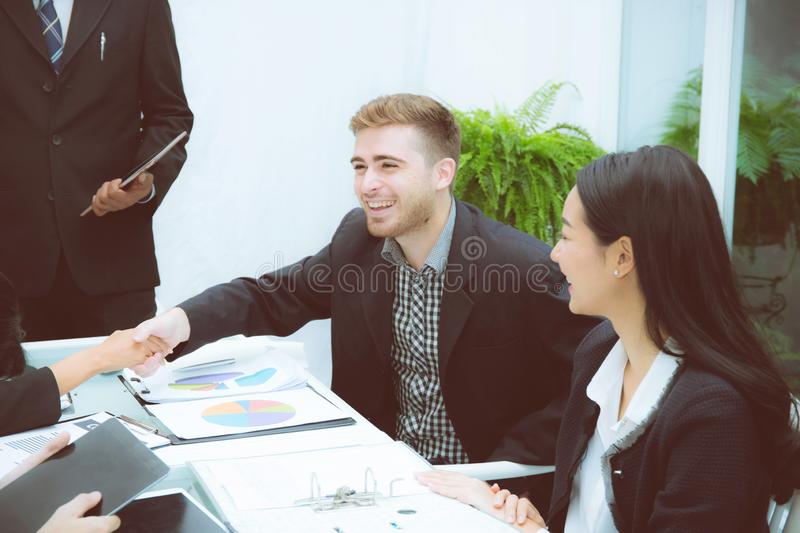 Group of business team people shaking hand with success, agreement of discussion stock photography