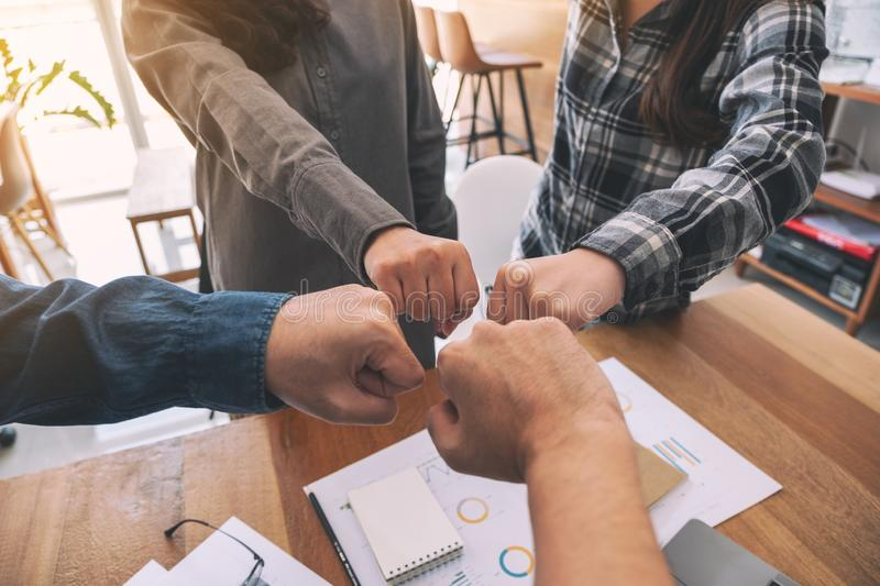 Business teamwork join their hands together with power and successful concept stock photos