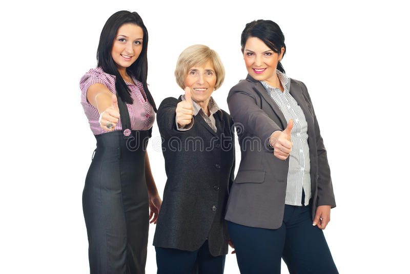 Group of business women giving thumbs stock images
