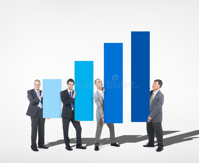 Group of Businessman Holding Growth Chart royalty free stock images