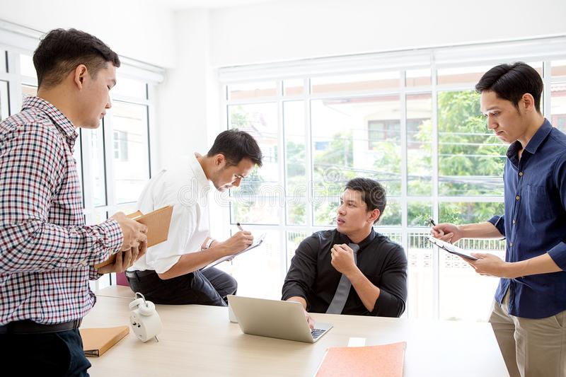 Group businessman plaining data at meeting. Business people meet. Ing around desk at the office. asian people stock photo