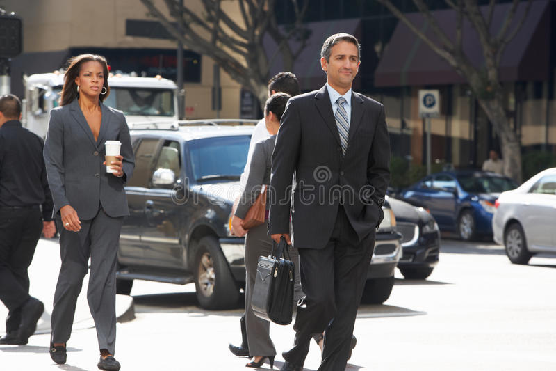 Group Of Businesspeople Crossing Street Stock Image