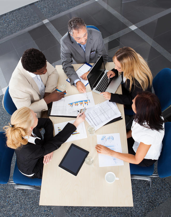 Group of businesspeople discussing together royalty free stock photos
