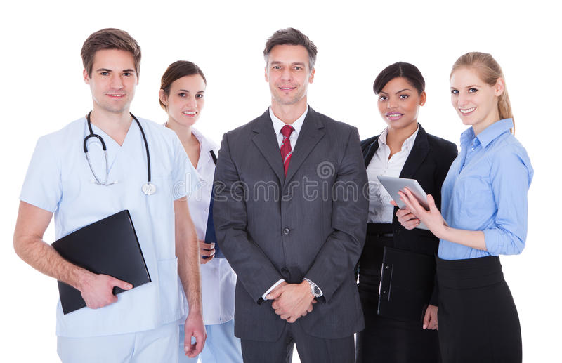 Group of businesspeople and doctors. Happy Group Of Businesspeople And Doctors Standing Over White Background royalty free stock photography