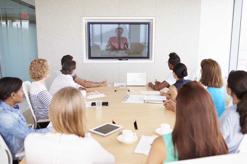 Group Of Businesspeople Having Video Conference In Boardroom royalty free stock photos