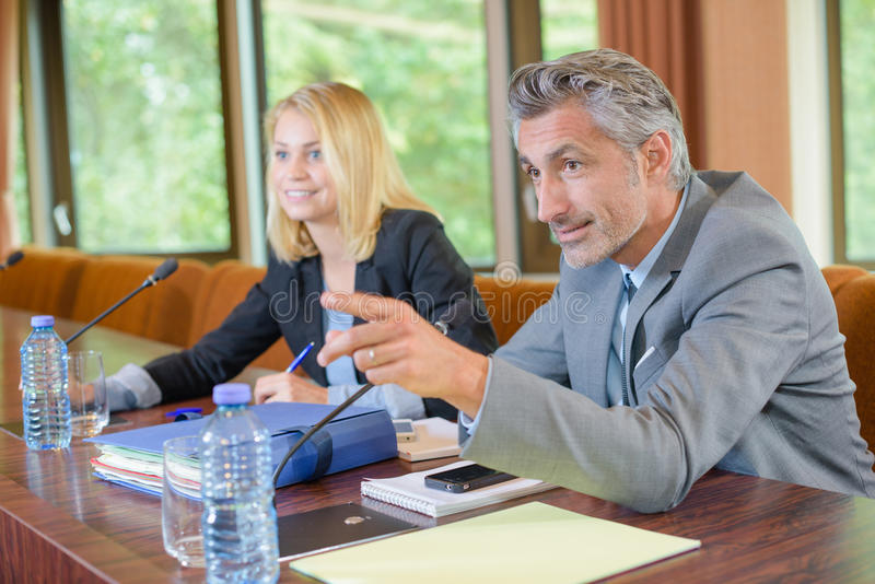 Group businesspeople having video conference in boardroom royalty free stock image