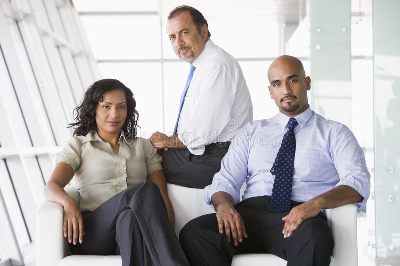 Group of businesspeople in lobby royalty free stock photos