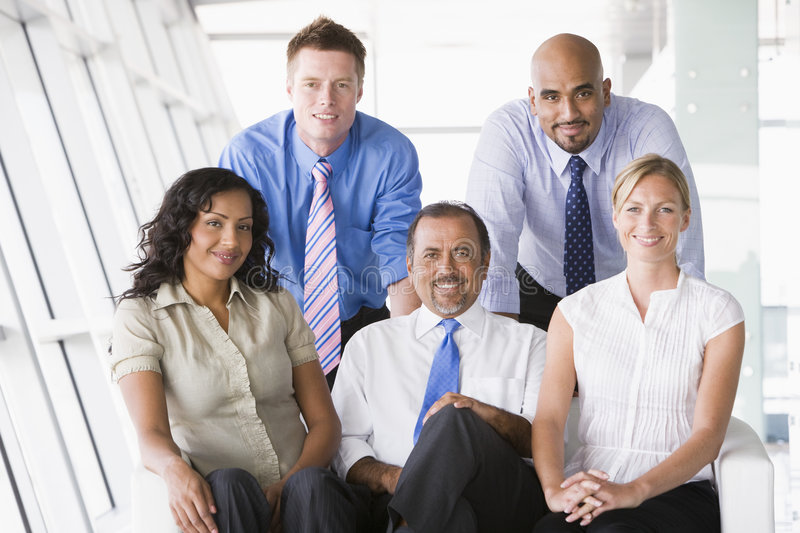 Group of businesspeople in lobby royalty free stock image