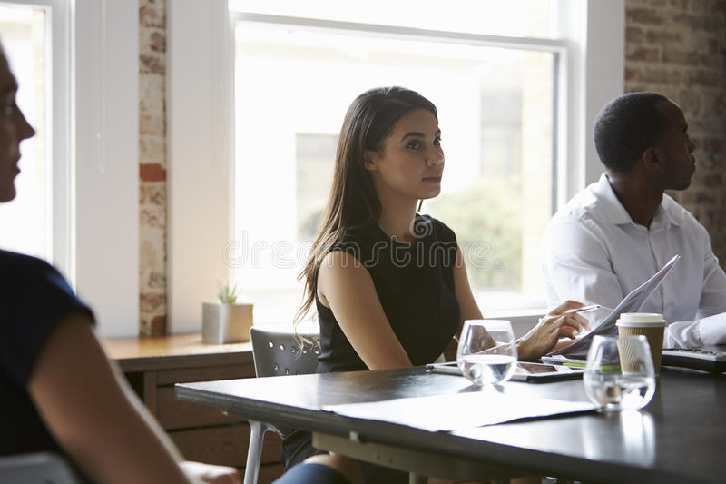 Group Of Businesspeople Meeting In Modern Boardroom stock photography