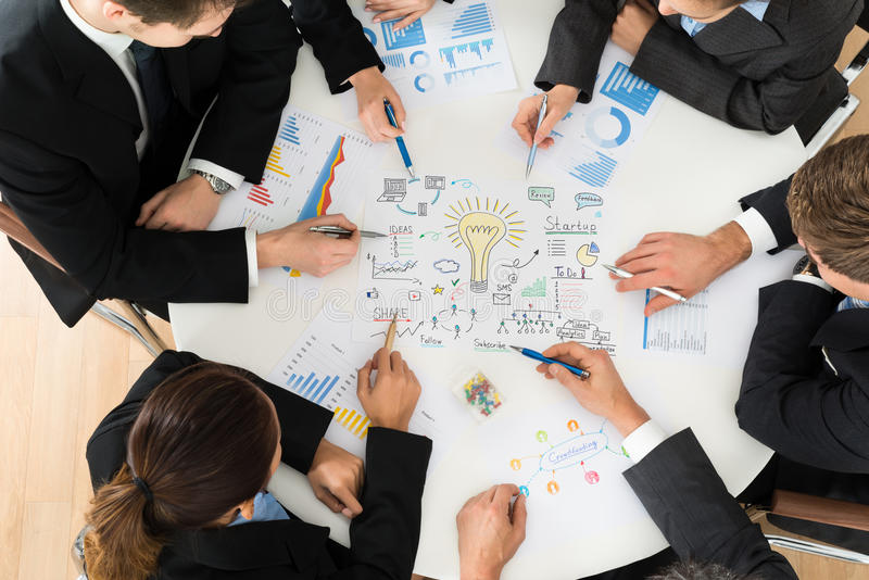 Group of businesspeople planning for startup stock photography