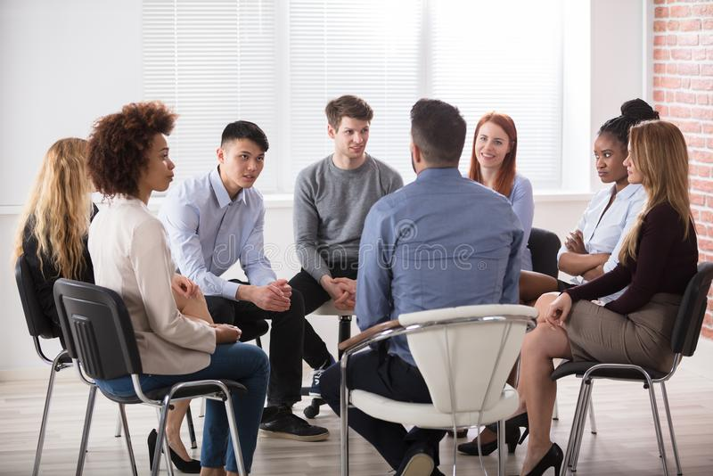 Group Of Businesspeople Sitting On Chair royalty free stock photos