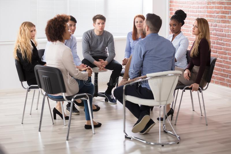 Group Of Businesspeople Sitting On Chair stock photos