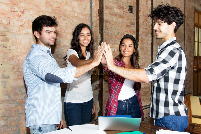 Group of businesspeople of start up company giving high five stock image