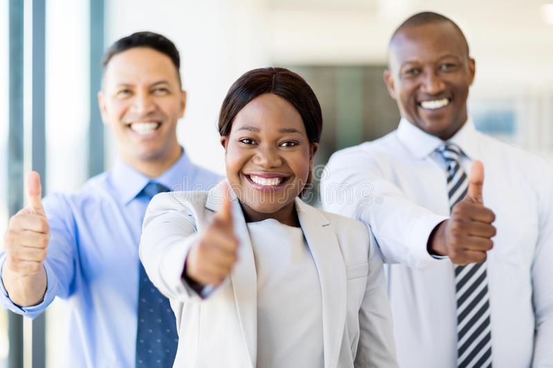 Group of businesspeople thumbs up. Group of successful businesspeople giving thumbs up royalty free stock photography