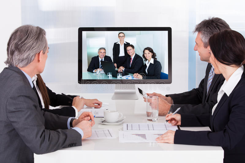 Group of businesspeople in video conference stock photo
