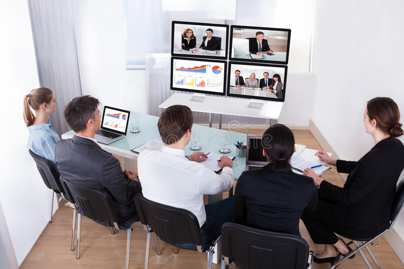 Group of businesspeople in video conference stock photography