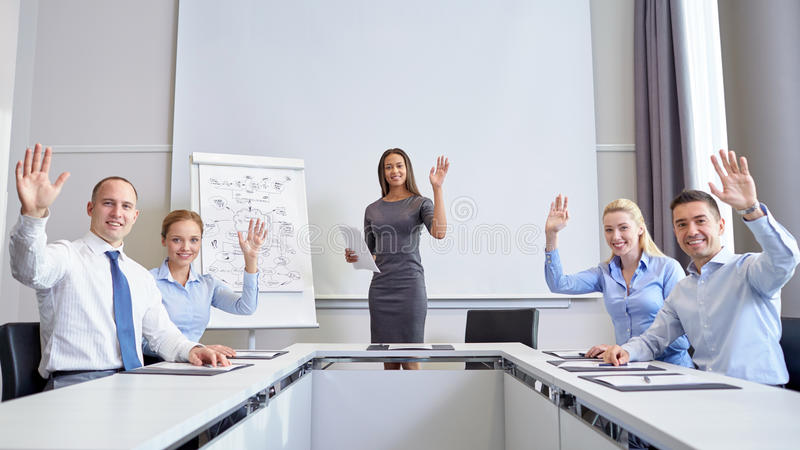Group of businesspeople waving hands in office royalty free stock image