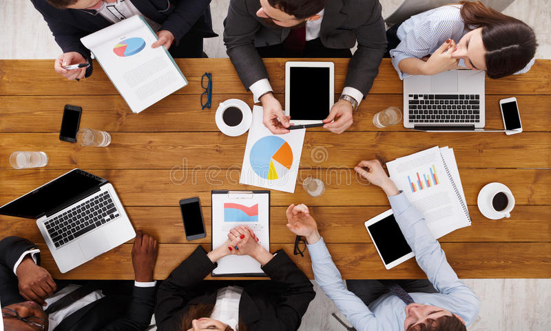 Group of busy business people meeting in office, top view royalty free stock photos