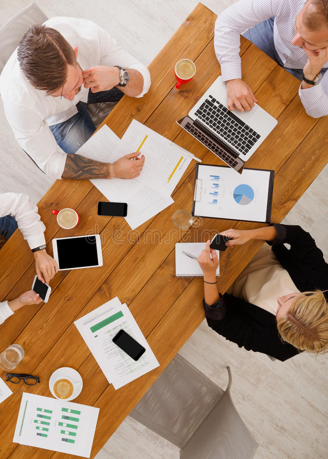 Group of busy business people working in office, top view stock image