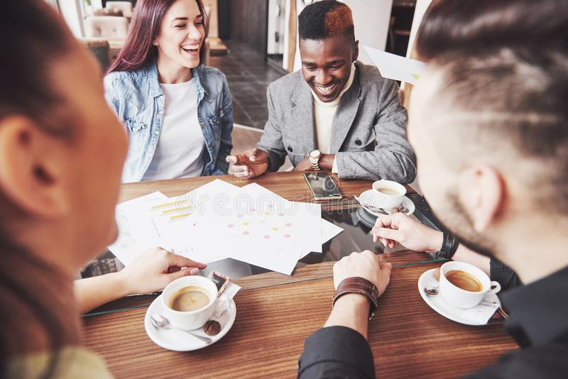 Group of casually dressed businesspeople discussing ideas. Creative professionals gathered for discuss the important stock photos