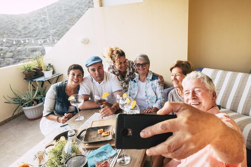 Group of caucasian people men and women celebrate together at home in the terrace - christmas dinner or birthday party - adult man stock images