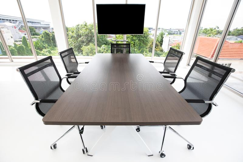 Group of chaira around table in meeting room stock photography