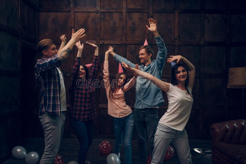 Group of friends dance at birthday party stock photos