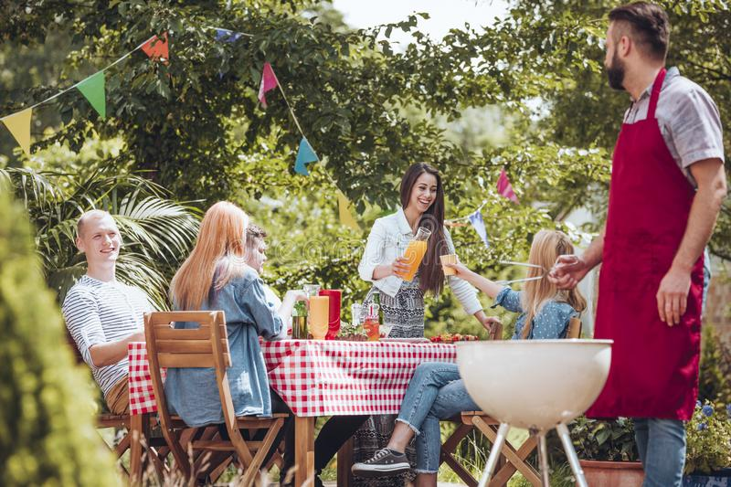 Friends partying in garden stock images