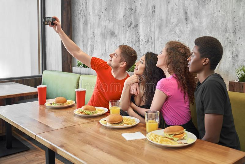 Friends doing selfie on phone in cafe. stock photography