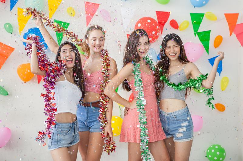 Group of cheerful young people celebrating together over New yea royalty free stock photo