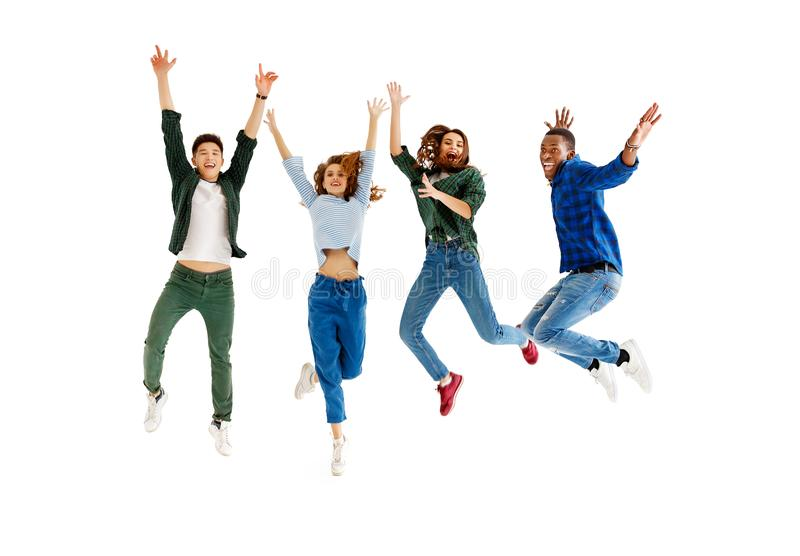 Group of cheerful young people men and women isolated on white background stock image