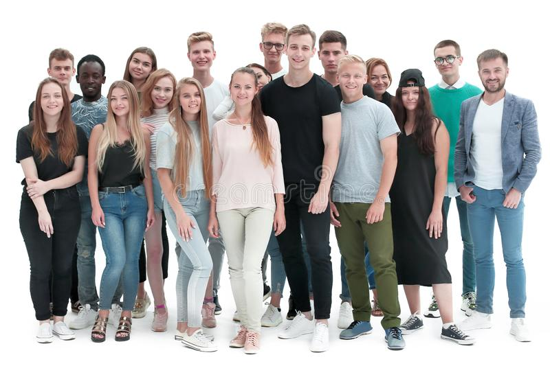 Group of cheerful young people standing together stock images
