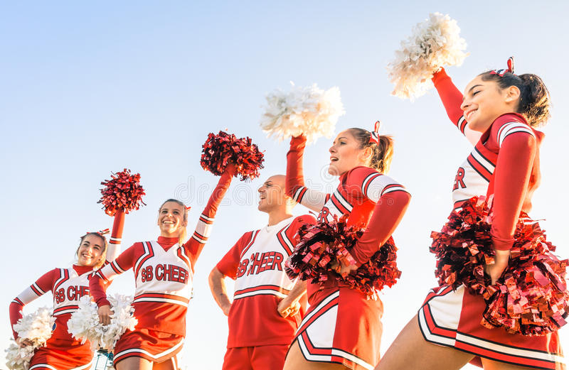 Group of cheerleaders in action with male coach. Concept of unity and team sport - Training at college high school with young female teenagers royalty free stock images