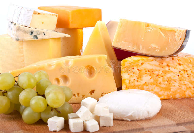 Group of cheeses with grapes royalty free stock photos
