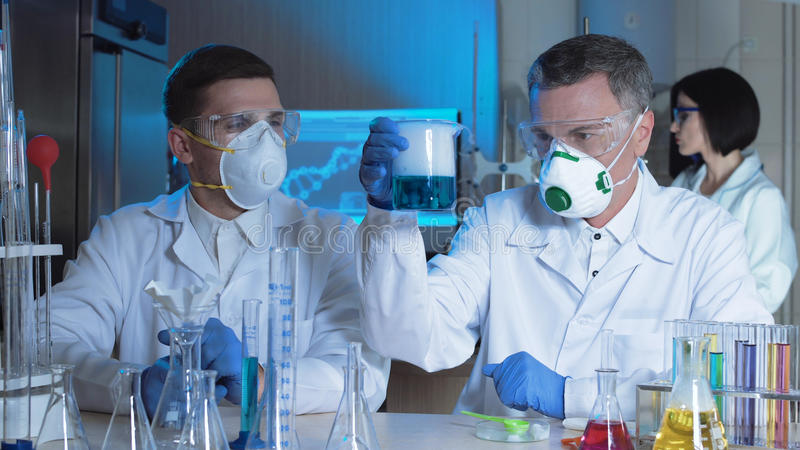 Group of chemists working in a laboratory stock photography