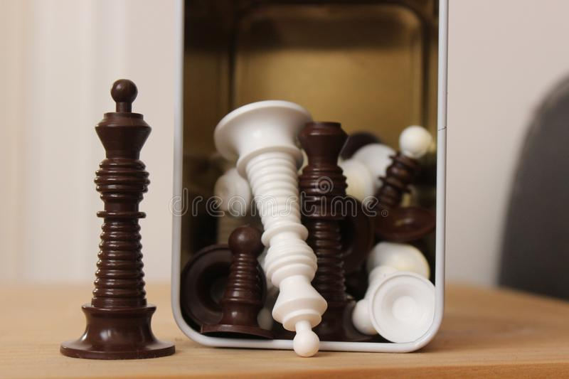 Chess pieces in front of a metal container stock images