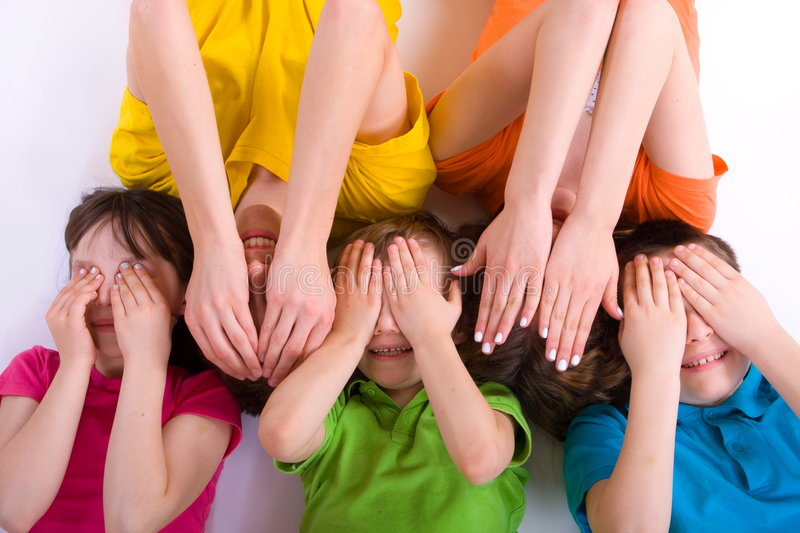 Group of Children. Group of five children covering their eyes with their hands stock images