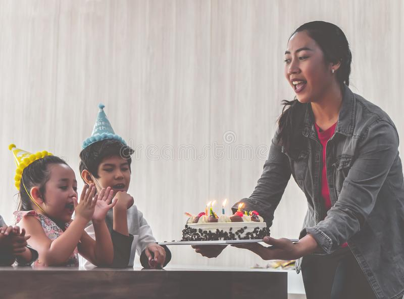 Group of children blowing birthday cake in birthday  party singing happy birthday. Group of children is blowing birthday cake in birthday  party singing happy stock photography