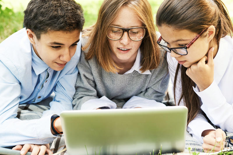Group of Children Browsing Internet Outdoors stock photos