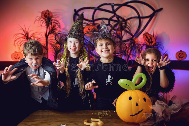 A group of children in costumes on a Halloween holiday royalty free stock images