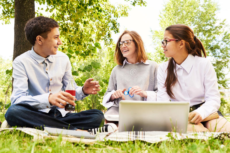 Group of Children Enjoying Picnic Outdoors royalty free stock photography