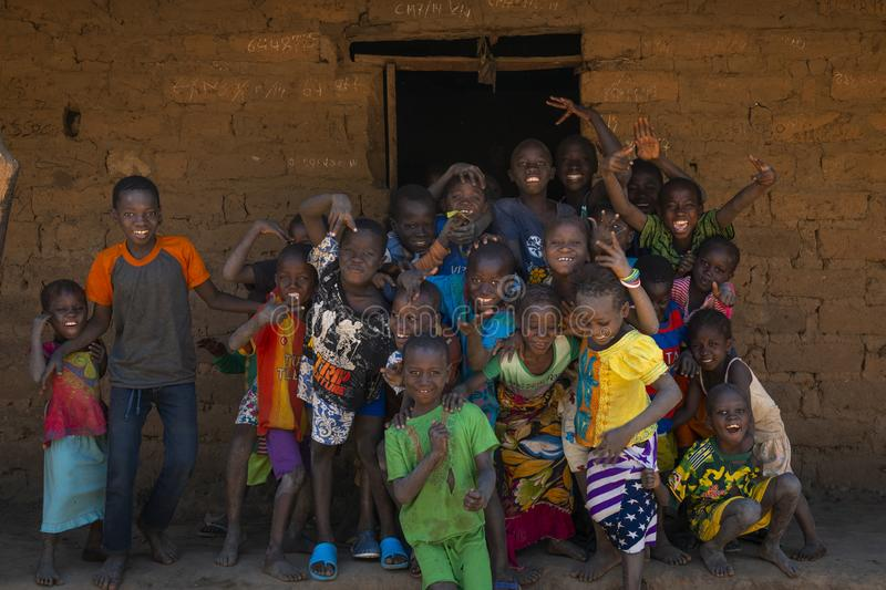 Group of children in front of a house in the village of Mandina Mandinga in the Gabu Region stock photo