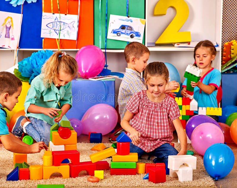 Group children game blocks on floor royalty free stock photography