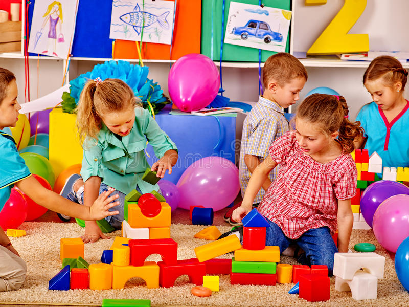 Group children game blocks on floor . Large of group children game blocks on floor in kindergarten royalty free stock images