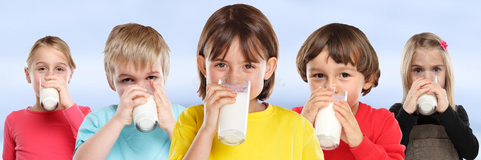 Group of children girl boy drinking milk kids glass healthy eating banner. Young stock images