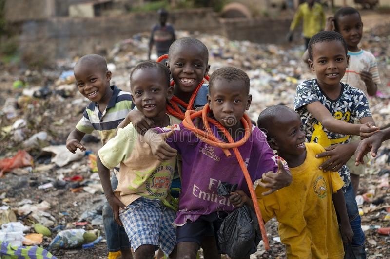 Group of children at a landfill in the city of Bissau, in Guinea-Bissau. Bissau, Republic of Guinea-Bissau - February 8, 2018: Group of children at a landfill in stock photo