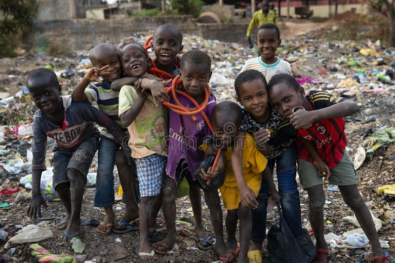 Group of children at a landfill in the city of Bissau, in Guinea-Bissau. Bissau, Republic of Guinea-Bissau - February 8, 2018: Group of children at a landfill in royalty free stock image