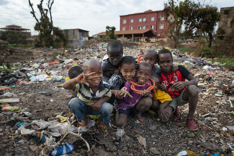 Group of children at a landfill in the city of Bissau, in Guinea-Bissau. Bissau, Republic of Guinea-Bissau - February 8, 2018: Group of children at a landfill in stock photography