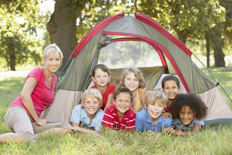 Group Of Children With Mother Having Fun In Tent In Countryside royalty free stock photography