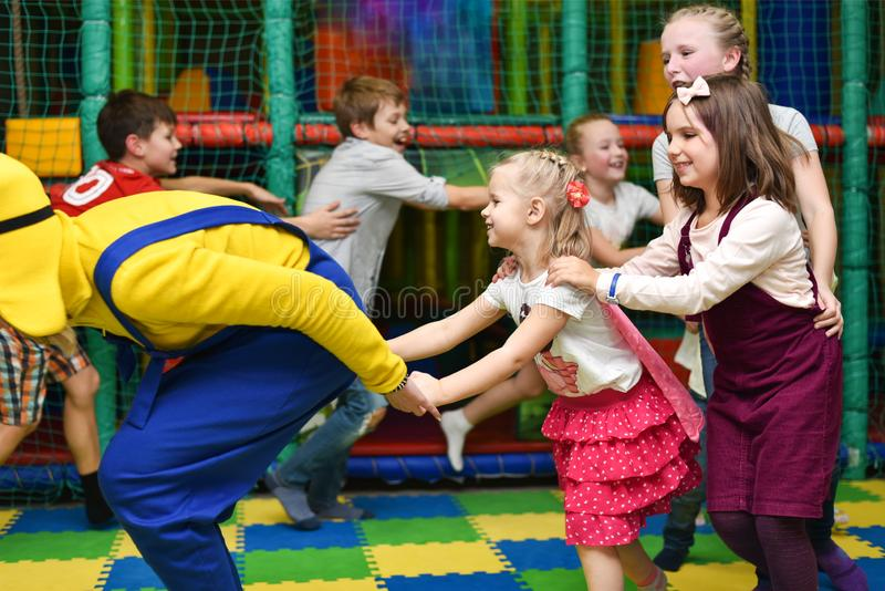 A group of children at a party play, run for the animator and hold hands.  royalty free stock images